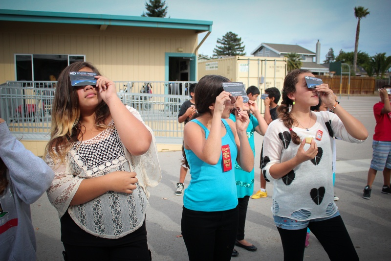 Students view partial solar eclipse